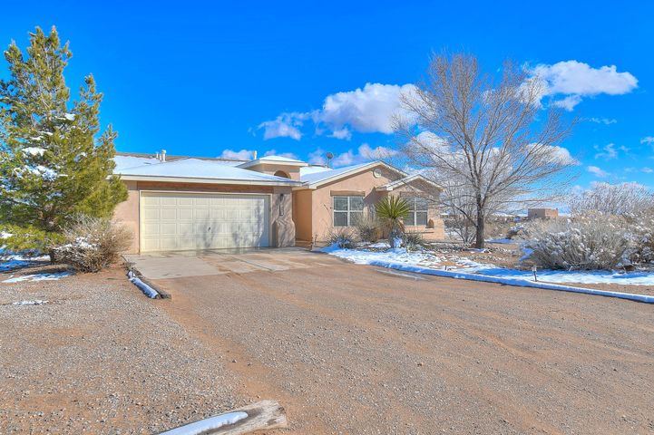 This single story home sits on a half acre lot in Rio Rancho Estates. Bright, open functional floorplan offers 2 living areas, formal dining room, eat-in kitchen, study/office, 3 bedrooms and 2 1/2 baths. Three way gas log fireplace between living and great rooms. Big breakfast nook, bay window, island with breakfast bar, pantry, stainless steel appliances including refrigerator, gas stove/oven, microwave, dishwasher in kitchen. Master suite includes large walk-in closet, double sinks, garden tub, separate shower. Two additional spacious bedrooms and full bath with double sinks. Private, landscaped backyard with beautiful views, covered patio, trees. Refrigerated air conditioning, raised ceilings, skylights, two car garage, backyard access.