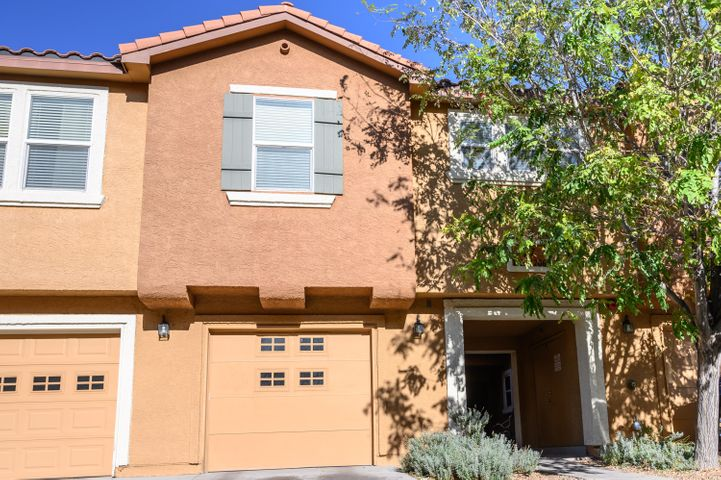Move In Ready Condo in the desirable gated community of The Villas.Beautiful 3Bed/3Bath. Updates include newer flooring, counter tops, tankless water heater and fresh paint throughout. Stainless Steel Appliances & Refrigerated Air are a Bonus! Large Master includes Huge walk in closest. Gated community amenities include access to community pool, playground, security, and clubhouse available for rental .Close to UNM & CNM. Easy Access to I-25 to get you to Uptown or Downtown.