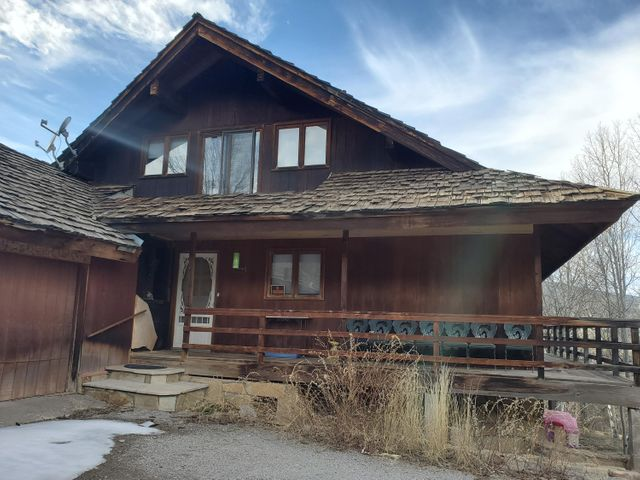 This diamond in the rough needs some TLC to return it to its recent glory.  Located just 4 miles up Nth Hwy 14, the location provides for an easy commute to Abq, while experiencing mountain living.  Awesome views from large windows.  Wrap around deck. Lots of trees, including aspens. Hardwood floors. Great room has beautiful wood ceiling and walls with exposed beams. 2 kitchens for separate living spaces on each floor. Upper floor kitchen has granite tile counter top. Loft would make a great office or hobby space.  Great opportunity for investor or simply a homeowner wanting to invest in sweat equity. Property is sold ''As Is''.