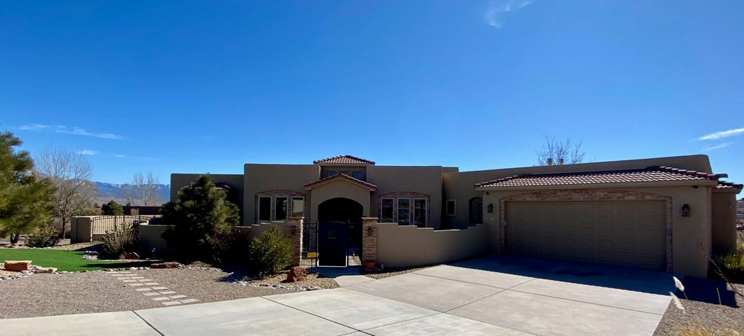 Enjoy mountain & city views from the inside & outside of this tasteful custom home. Single-story, on an acre lot, fully fenced with a wall backyard and courtyard entry plus backyard access and a gated entry with auto opener and beautifully landscaped with trees and xeriscape. The interior is a light open concept with a large great room with stacked stone walls, Kiva fireplace, flagstone bancos, built-ins, beam ceilings and views. The well-appointed kitchen is perfect for cooking or entertaining with double ovens, five burner gas cooktop, granite countertops, walk-in pantry, island with bar space and breakfast nook. The spacious master suite has a sitting area, gas log fireplace, patio and hot tub access, separate sinks and walk-in closets, a jetted soaking tub and separate shower.