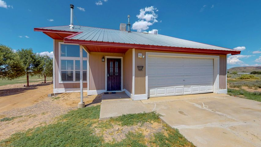 Country living at it's finest! This adorable 2 bedroom home sits on just under 2.5 acres of land! Just a 10 minute drive from I-25. Views for Days! Home features hardwood floors, fully fenced property with round pen, 2 master bedrooms each with it's own bathroom, covered patio, and 2 car garage!