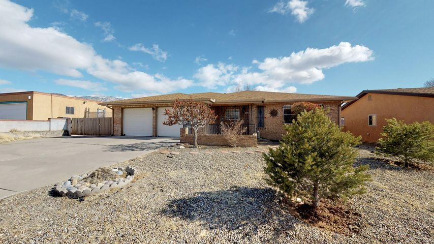 MOVE IN READY!! With new tile floors in the kitchen, new laminate wood floors in living spaces and bedrooms, and a new roof makes this property a MUST SEE!