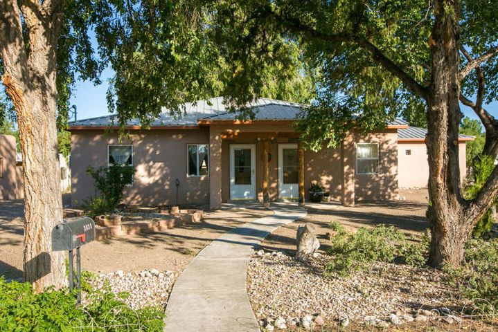 Welcome to this lovely single story home in beautiful North Valley, built in 2007 by Rudy Garcia custom builder.  Amazing opportunity and potential, corner lot on .29 AC w/backyard access.  Versatile floorplan, open kitchen/living/dining with possible third bedroom, or formal dining room with 2 bedrooms, you decide.   J&J bath between bedrooms, handicap access shower, separate tub and shower and two sinks. Plus half bath.  Walk in closets. Home is handicap accessible, kitchen cabinets are built to accommodate wheelchair access.  Kitchen Cabinet has an insert for dishwasher.  Short driving distant to La Montanita CoOp and Nature Trails.  Lots of potential!  .