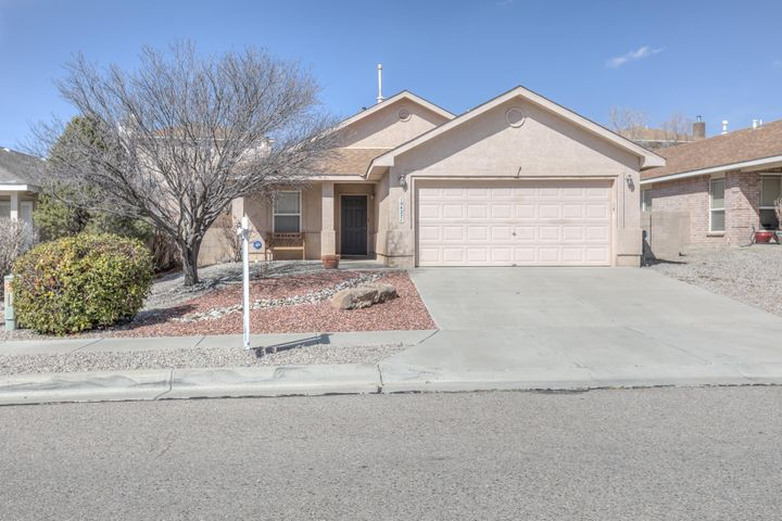 Darling 3 bedroom 2 bath home in Cottonwood Hills Sub!   This home offers a spacious living room open to the kitchen and breakfast nook.  Enjoy your summer evenings on the covered front or back porch.  Close to shopping, restaurants, Coors and Paseo Del Norte.