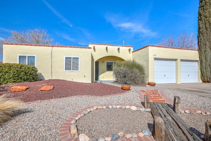 Don't miss this lovely one-story home at Academy Place in the heart of NE ABQ.  Four bed, 1-3/4 bath home with 9-ft ceilings in main living areas, lots of windows and light!  French doors in the kitchen nook area overlooks back yard pergola and raised garden beds. Wood burning fireplace for cozy winter nights.  8x10 finished workshop with electricity. Front yard xeriscaped.  Updates 2016-2020 include new roof, evaporative cooler, furnace, stucco repair/painted, dishwasher, oven, stove top, disposal, carpet, fresh paint in living/dining/kitchen areas.  Thermal windows in 2007. Finished 2-bay garage and garage doors replaced in 2010.