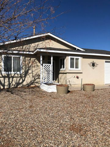 This wonderful two bedroom home on a large lot is ready for move in!  Lots of windows to let in natural light. Enjoy relaxing evenings and sunset views from your backyard.  No poly pipes, no carpet.  Refrigerated air. Backyard access.   Plenty of room for your toys (RV, four wheelers, etc) in this large backyard!