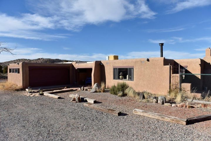 Placitas Horse Property, Secluded but with easy access to I-25. Cute and Quaint with Wood Floors, Newer TPO Roof, 1.3 Acres and Room For Guest House near Well and Septic hook up. Walking Distance to National Forest Open Space, Trails and Delightful Views. Mostly Flat, Usable Lot.