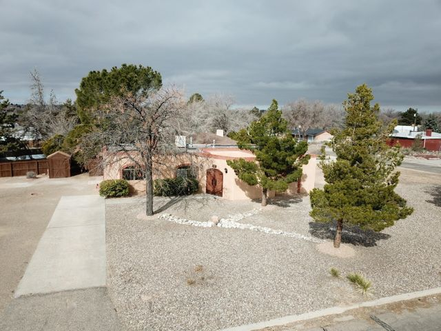 Virtual Tour Available!!(Zillow its in facts and features, interior details). Don't miss your opportunity to call this gorgeous, fully renovated, Rio Rancho Estates property, your new home!!  Location Location Location..  This property is situated on a large 1/3 acre corner lot in close proximity to shopping and restaurants.  Featuring smart home amenities including, voice activated thermostat, light switches, and kitchen TV.  The beautiful kitchen has new custom kitchen cabinetry, granite counter tops, new stainless steel appliances, and custom back splash.  Both baths won't disappoint with custom tile work, back lit vanity mirrors, custom shower fixtures, granite counter tops and more.  This home is ready for you to  move in today.  Schedule your showing today!