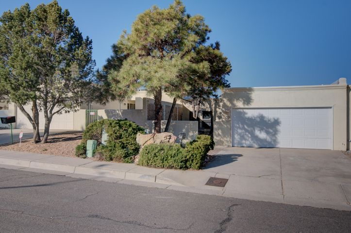 If you're looking for VIEWS, wait no more....this lovely townhome is located at the base of the Sandia Mountains. Excellent mountain and city views. Secluded cut-de-sac location. 3 Bedrooms 2 Bathrooms 2 Car Garage. Great courtyard in the front and deck in the backyard. Do no wait on this little cutie.