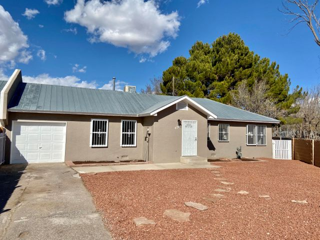 Welcome to the North Valley. Single family home 3 bedroom 2 full bathrooms.  Newly  remodeled bathrooms and kitchen.  New paint and all new flooring .. New stainless steel appliances. Fully fenced with electric gate opener.  Large cover patio deck just off the kitchen.