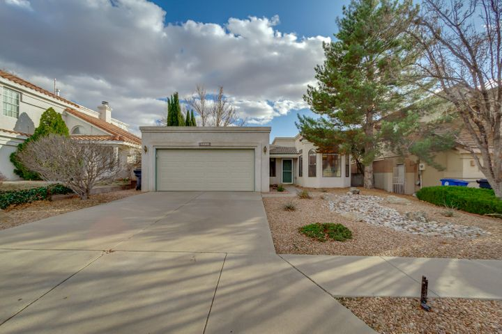 Cute and Move in ready!! Refrigerated air conditioning and gas fireplace are a plus.  This one level 3 bedroom/2 bath home in a desirable neighborhood is close to La Cueva High School.  There is tile flooring throughout the home with the exception of the carpeted bedrooms. Granite counter tops in the kitchen with a nook. Updated bathrooms. Light flows into the home through the many windows. The washer and dryer convey in the large service room. Relax in the lovely landscaped backyard. This home won't last long!!!