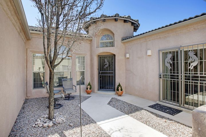 This BEAUTIFUL home, in the highly sought after, Watershed Community, with access to the Petroglyphs and trails, boasts VIEWS from the kitchen, living area, and back patio, and has been IMMACULATELY kept! Master Bedroom and bathroom is ADA Compliant and Wheelchair accessible with back patio access door, and huge walk-in closet. ''Casita'' like, Front bedroom has its own separate entrance and access to a bathroom. A few of the features and updates include: Custom Tile throughout, Oversized Double garage, Refrigerated air and heat Combo unit, Water filtration system, INSTANT Hot Water system to Master bedroom, Very beautiful and durable Karastan Carpet throughout the home in non-custom tiled areas. New Water heater in 2017, New garage door and opener in 2019 (controllable through phone)