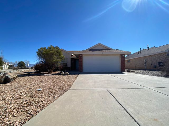 Stunning home on a large corner lot in a homey Los Lunas neighborhood.  This 3 bedroom, 2 bath home features sleek tile flooring, a cozy fireplace in the living area, and a bright floorplan.  The large ktichen has plenty of counter space with tile countertops, a breakfast bar, and a large bay window.  Each bedroom is spaciously sized and perfectly situated for privacy and relaxing.  The master bedroom features a walk in closet and a personal bathroom with tile blacksplash.   Plant shelves throughout the home for easy and natural decorating. Both the front and back yards have easy to maintain and eye appealing landscaping.  Come call this house your home today!