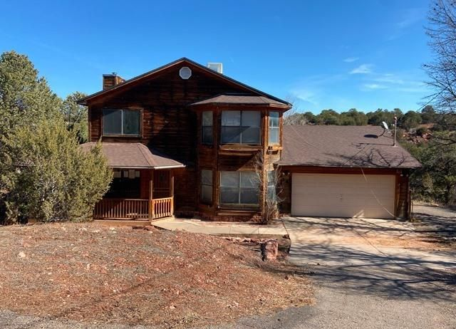 Nice mountain retreat on 1.02 acre. Property features 3 bedrooms, 2.5 baths, alarge kitchen with center island and living room with lots of natural light. The home is in need of some TLC but could be a great getaway with a little work.