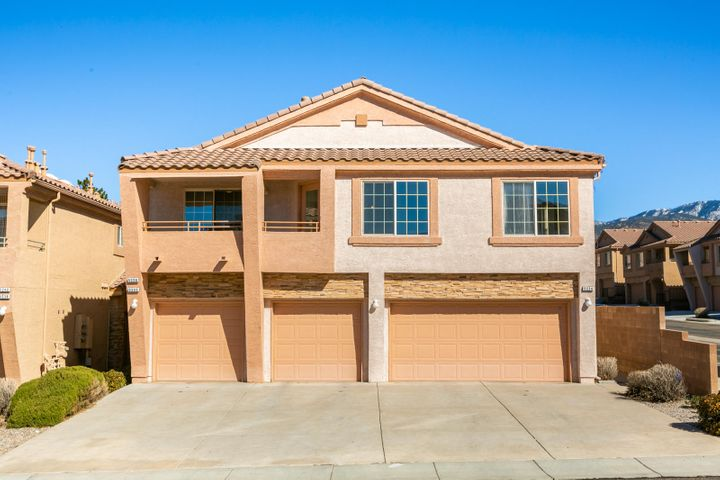 Wonderful move-in-ready condo in the gated Pacifica Community! Home features 1,062sf with 2 bedrooms, 2 bathrooms and a n attached garage. New laminate flooring, carpet and paint! Great open floorplan with a spacious living area with gas fireplace, built-in shelving and a private balcony. Kitchen offers new appliances including the refrigerator! Large master suite with access to balcony and a private bath. Bath with a walk-in shower with tile surround and a make-up area. Close to parks, walking trails, shopping and CNM Montoya Campus.