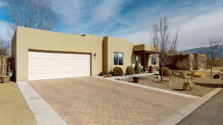 Bosque Home that shows like brand new!  This home is located in a gated community close to the Rio Grande Bosque. Home includes Granite kitchen counters, stainless steel appliances, tumbled travertine stone tile, rock accents, 3 bedrooms, master bath with dual sinks and a walk-in shower. Backyard is spacious, with covered patio and xeriscaped for little to no maintenance.  Solar system that allows for no electric bill year round.