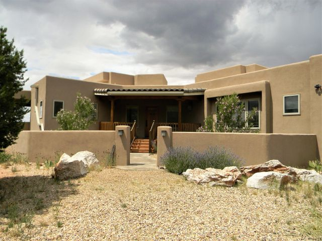 Gorgeous landscapes! Scenic views! 300 days of sun per year! All this awaits you in this Pueblo style home located in the gated community of Deer Canyon Preserve and is only 10 minutes from the quiet town of Mountainair. The main house has 2 bedrooms, 2 baths, tile throughout, radiant floor heating, spacious 2 car garage, 2 kiva fireplaces, beautiful wood beam ceilings, and RO system for whole home. The detached 1 bedroom, 1 bath Casita will make a great in-law suite, game room or artist studio. Don't wait to view this stunning property!