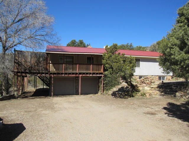 This spacious East Mountain property is located on over an acre of land! Gorgeous mountain setting with views from the deck. Make this property into your dream retreat!