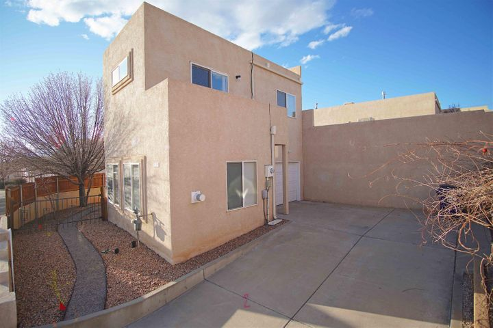 Come check out this perfect starter home in a FANTASTIC location, before its too late!  This home has new carpet, fresh paint throughout, a new stove, and is super clean from top to bottom. It is truly turn key ready!! Very close to parks, grocery stores, restaurants, bars, CNM, and many other great amenities in the area. Both bedrooms have walkout decks with great views. The master has a STUNNING and unobstructed view of the Sandia mountains. Cozy corner Fireplace in the living room, with an open concept into the kitchen. There is also a 1 car garage up front by the entry door for easy access, and walk-in closets in each bedroom. There is not much on the market and you do NOT want to miss this GEM!!