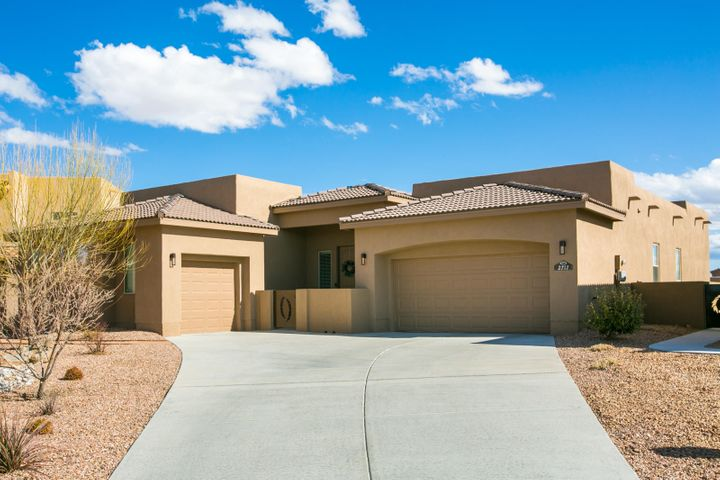 Impeccable Twilight Home located in the popular Mariposa community of Rio Rancho. Home features 2,600sf with 4 bedrooms, 2.5 bathrooms and a 3 car garage.  Open Floor plan with wood-look tile throughout the main living spaces. Stunning kitchen with custom white cabinetry, quartz countertops, built-in oven/microwave, gas cooktop, range hood, high-end lighting and a huge island with high-top bar and seating area. Great living area hosting a custom fireplace with stacked stone accents and a wall of sliding doors providing the perfect lighting. Spacious master suite with spa-like bath. Bath hosts dual sinks, quartz countertops, a relaxing garden tub, walk-in shower and closet. Enjoy dinner under the huge covered patio while taking in the amazing Sandia sunsets!
