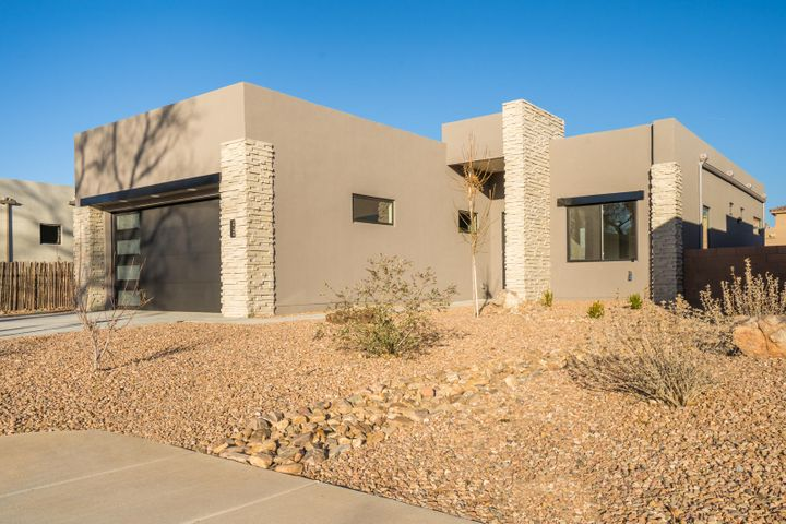 What a wonderful opportunity to be nestled in the heart of the North Valley directly along the Bosque Trail in a gated community of only 10 new homes. Built with the quality that you would expect of a Sivage home, this home features high end finishes such as designer selected paint colors, beautiful porcelain tile floors, rich soft close cabinetry, stainless appliance suite, quartz counters, and 8' tall doors. Enjoy easy access to wonderful dining, entertainment, shopping and outdoor activities. This floor plan was thoughtfully designed for entertaining, and offers 3 generous bedrooms, a thoughtfully designed kitchen open to the living and dining rooms, a large master suite with a separate tub & shower, and a large walk in closet. Enjoy the lifestyle associated with a single story home.