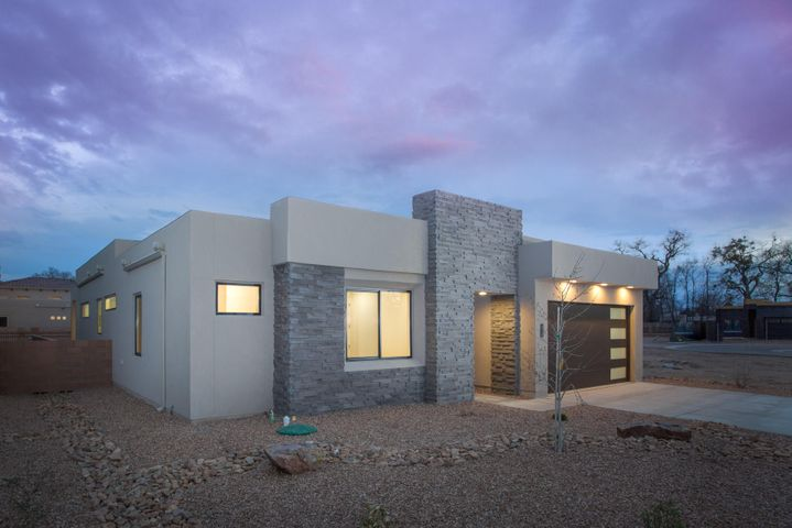 What a wonderful opportunity to be nestled in the heart of the North Valley directly along the Bosque Trail in a gated community of only 10 new homes. Built with the quality that you would expect of a Sivage home, this home features high end finishes such as designer selected paint colors, beautiful porcelain tile floors, rich soft close cabinetry, stainless appliance suite, quartz counters, and 8' tall doors. Enjoy easy access to wonderful dining, entertainment, shopping and outdoor activities. This floor plan was thoughtfully deigned for entertaining, and offers 3 bedrooms and a study, a thoughtfully designed kitchen open to the living and dining rooms, a large master suite with a separate tub & shower, and a large walk in closet. Enjoy the lifestyle associated with a single story home.