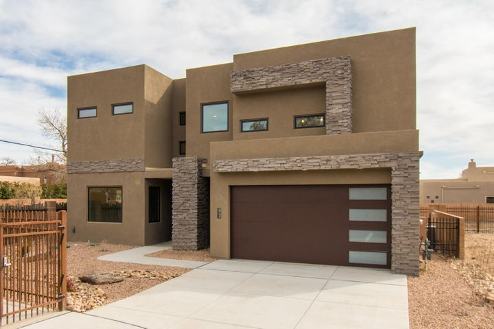 What a wonderful opportunity to be nestled in the heart of the North Valley directly along the Bosque Trail in a gated community of only 10 new homes. Built with the quality that you would expect of a Sivage home, this home features high end finishes such as designer selected paint colors, beautiful porcelain tile floors, rich soft close cabinetry, stainless appliance suite, quartz counters, and 8' tall doors. Enjoy easy access to wonderful fining, entertainment, shopping and outdoor activities. This floor plan was thoughtfully designed and offers a main level master suite, a great room & dining room overlooking the backyard and with direct access to the patio, and a beautifully designed open kitchen. Upstairs there are 2 bedrooms with en-suite baths, walk in closets, a loft, & huge deck!
