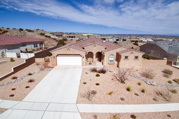 Quality and upgrades abound in this Mariposa Sivage beauty.  Enjoy forever views on your .51 acre lot.  Whatever the occasion, this home's welcoming open floor plan provides the perfect space.  Master retreat has a HUGE walk in closet and spa like bath complete with 2 vanities and soaking tub.  Two beautiful guest suites.  Cooks dream kitchen featuring sizable island beautiful granite and custom tile work that compliment  rich espresso cabinetry.  Backyard is a delightful place to relax and enjoy the beauty of the southwest.  Call to arrange your private viewing today!