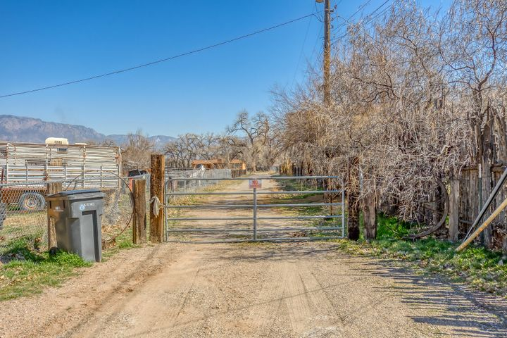 Special Opportunity in the North Valley! This 2.834  parcel is perfectly located for development! Create your very own private compound or subdivide and build. The property has a 1350 sf house that has some structural issues and will convey '' as is''Access to endless trails and open space. Nestled under cottonwoods , peace and tranquility