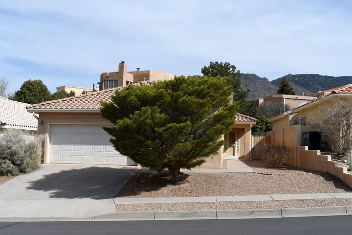 Delightful, One Level (NO steps), light and airy home in sought after  Sandia Hills.  Open space across the street with hiking and biking trails. Lovely Embudo Hill park a couple blocks away. Recent updates: Evap Cooler 2015, Hot Water Htr. 2016, Gas Furnace 2016, Shower glass door 2017, Entire home re-stuccoed 2018, Gutter system 2019, both commodes replaced 2018, Garage door motor replaced 2019, Gourmet granite kitchen countertops 2019. Recent vent hood over gas stove. California redwood deck in bkyd. High privacy wall in back and raised side wall with security gate. Wood blinds, 3 ceiling fans, raised cathedral type ceilings, block glass accents. Attic over garage with ample storage. Lovely home!