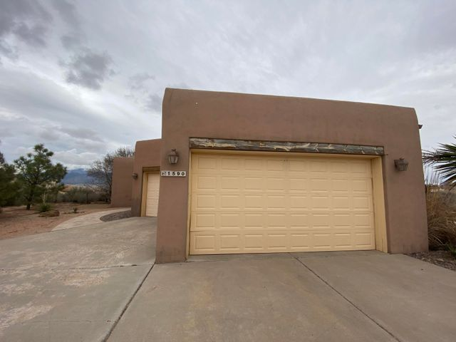 Welcome to Rio Rancho! This is a 4 bedroom 2.5 bathroom home with an open floor plan.  It has two master suites, private well, oversized 3 car garage and entire back yard is fenced. The home sits on .79 of an acre with side yard access and amazing views. The home is an estate sell and will be sold ''AS IS''