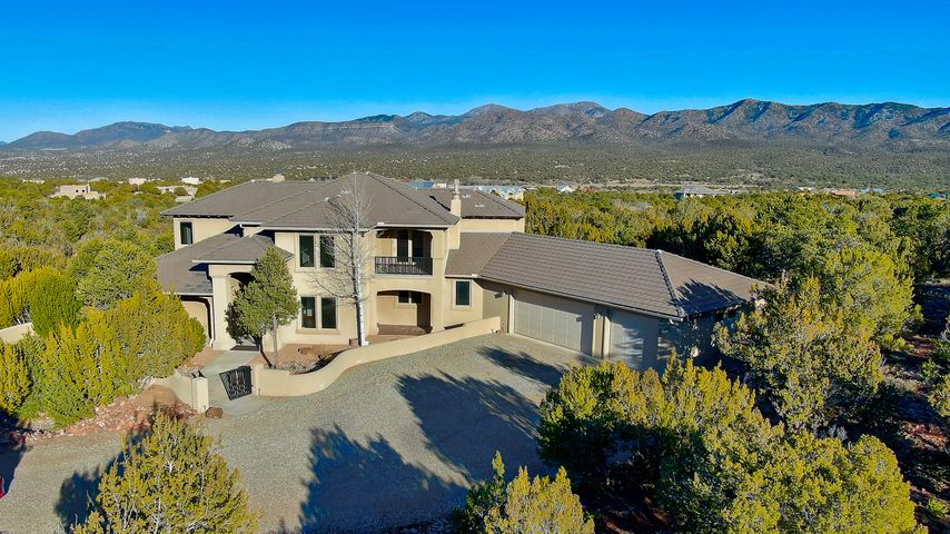 360 degree mountain views are waiting for you in this beautiful custom home on 6+ acres.  Exceptional wood and tile finishes with formal and private spaces to enjoy both inside and out.  Cozy up to a woodburning fireplace in the main living room. Let your guests enjoy the comforts of the separate family room.  With a walk-in pantry, a formal Dining Room and a Breakfast nook and Breakfast bar you will enjoy entertaining your guests while preparing your best meals in the custom Kitchen.