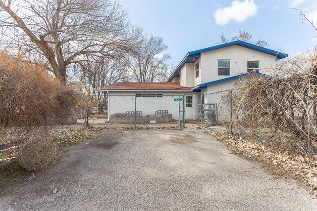 Spacious 2 story home on a large lot. Property features 5 bedrooms, 3 baths, anopen kitchen with lots of cabinet space and extended living room with woodburning fireplace. The property is in need of some TLC but has potential.