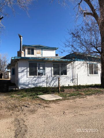 Nice North Valley location.  This property has potential.  Nice lot with backyard access and detached garage.  Interior has large kitchen separate dining room Living room with corner fireplace.
