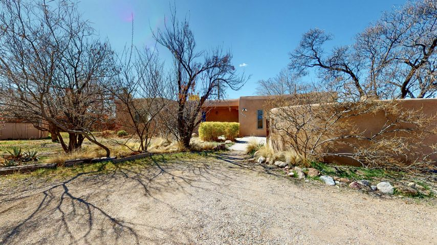Welcome to this Bright, Beautiful, Single-Story Pueblo-Style Casa in the North Valley! *East-Facing Home w/ Stunning Mountain Views!* Situated on a Large 1/3-Acre Lot, 1816 Paragon Court offers 3 Bedrooms *plus* a Huge Studio/Workshop Area that can easily be used as a 4th Bedroom or Second Living Space. Mexican Tile and Wood Beams accentuate the Southwestern Charm of this North Valley Dwelling! A Wood Burning Fireplace makes this Home feel Warm and Inviting. *Newer Stucco!* Enjoy Abundant Outdoor Living Space with Multiple Patios and Outdoor Kiva Fireplace! Look at the pictures and imagine how Lush and Green the Trees will look in Spring/Summer! All Appliances Included! The Studio has heating/cooling. Make an appointment to see 1816 Paragon today!