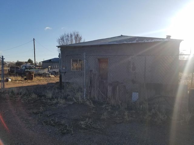 Fixer upper with 8X12 shed and 16x12 garage for storage. New electrical service pole to property. Property is completely fenced. Partial adobe home is a blank slate to remodel and redo how you want. Needs lots of work, but could be made into a nice small home with the right vision. Town of Mountainair is a great place to live in the rural Southwest. Make this your home or buy it for an investment property as there is a need for rentals in town. Walking distance to down town. Great value with lots of potential.