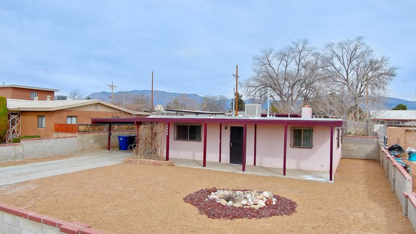 A gem disguised in a modest elevation.  This cute home is spacious, comfortable and priced to sell.  Enjoy the beautiful layout with 3 nice bedrooms and a wonderful living area.  Step outside to a very large backyard with custom covered patios, privacy and block walls.  Located in the heart of Albuquerque close to UNM, hospitals and I-40.