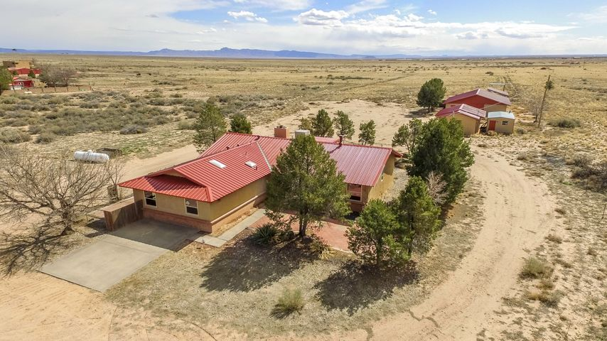 This home is priced significantly below market value to gain the most attention.   Wow! Views are incredible from this home! Check out this fully remodeled 4 bed, 3 bath home with over 2,200 square feet! Home is on over 5 acres and close to the freeway! 12 X 12 stalls. Nice 20 X 32 separate workshop w/220. A 12 X 24 separate building for storage or help quarters w/1/2 bath.  New Metal Roof, well pump, carpet, doors, and windows! Perfect barn for the horses!! Good size shop!  2 master suites! Call for your private tour today!!