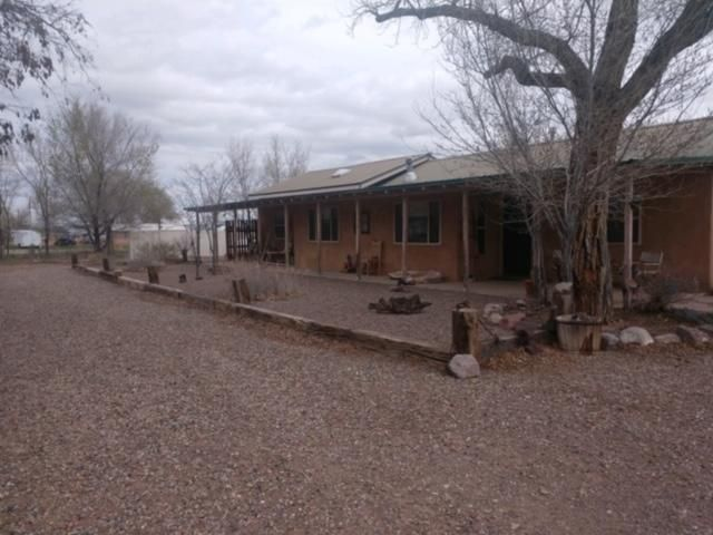 This is a great property  in the agricultural area of  Lemitar. 11.05 AC of MRGCD  irrigated water.The home has 3 bedrooms, 2 bathrooms, a huge sunroom, 35.5 x 10.5 is a great entertainment area. It has it's own A/C unit.  There is a workshop, a  dark room, a two car garage. Must see to appreciate.