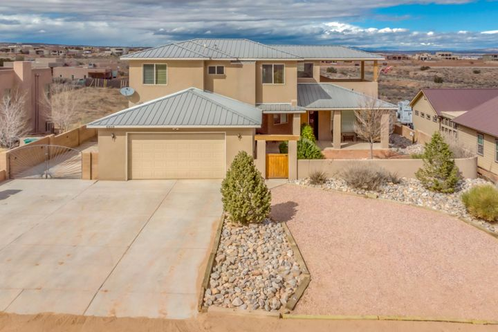 You Have To See This! Very Well Appointed Smart Home w/Captivating Views of the Sandia Mountains/Surrounding Areas.A Warm NM Welcome as You Enter the Gated Courtyard into the Main Foyer Bringing Natural Light In and Throughout.Feel at Home as you Pass Through the Family Room Into The Kitchen/Dining Featuring Granite Counters,Tile Back Splash,Island w/Extra Storage,Prep Space,Pantry.The Dining Area Opens to Raised Ceilings In The Main Living Room with Pellet Stove.Head Off to The Main Level Master Suite or Upstairs to 3 Additional Bedrooms.2 Back Doors Open to The Sprawling Park Like Backyard Equipped w/ Sprinklers,Solar Lights,RV/Boat Parking. +2 Covered Patios/Upper 2nd Story Deck,Ecobee Smart Thermostat,Ring Video Door Bell,3 Car Extended Garage w/2 Doors(Ask About MyQ Bluetooth Opener)