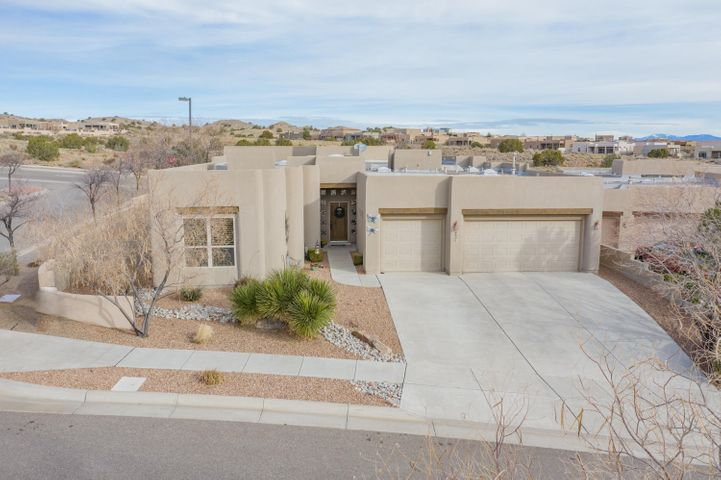 This Trememdous Home is the Original Model Home Located in Mariposa built by Scott Patrick Homes/Sky View. Beautiful, Bright, Open Floorplan with Soaring Floor to Ceiling Curved Window Wall with Custom Remote Blinds in Greatroom & Dining Room. Energy Efficient 2x6 Construction, R-19 Walls, R-38 Ceilings. Upgrades thruout! Chefs Gourmet Kitchen w/ Granite Countertops & SS Appliances. All Appliance stay! Romantic Masterspa Suite. 4th Bedroom or Study/Office located off  Grand Foyer Entry. Professionally Landscaped  Front & Back Yards, w/ Pretty Coved Patio Area. Located accross from Pretty Neighborhood Park. Mariposa also offers Neighborhood Community Center, indoor/outdoor Pools, Sports Areas. Near the New Santa Anna Star Center, Hospital, H/P, and a Quick 45 Minute Commute to Santa Fe!