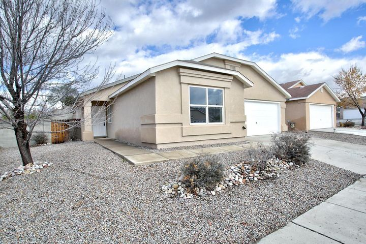 MOVE IN READY!!! 3 BR/ 2 BA  located in NW Albuquerque on a large corner lot.FRESH 2 TONE PAINT, NEW CARPET and NEW LIGHT FIXTURES! BRAND NEW SS APPLIANCES and plenty of counter space. Living area features high ceilings and a cozy gas fireplace. MASTER SUITE has a large bathroom and a WALK IN CLOSET!Come see for yourself!