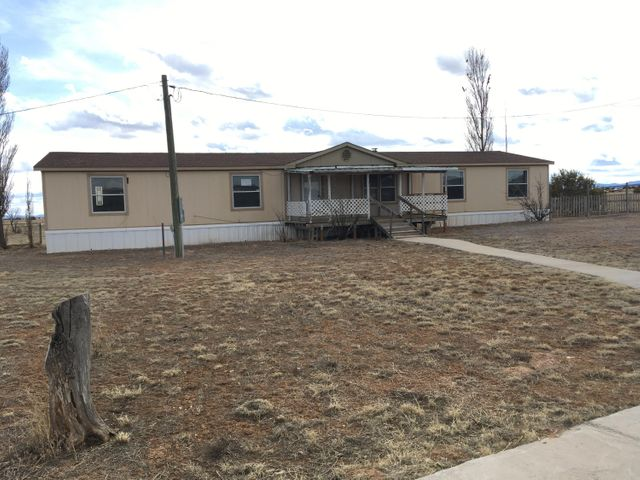 This 4 Bedroom, 2 1/2 bath Manufactured Home Sits On 10 Acres. There is a Large Detached Workshop.