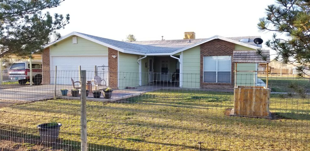 Pride of ownership shows in this 3 bed-2 bath home. Two large living rooms work well for entertaining friends and family. With the largest lot on the street, boasting 1.5 acres, there's plenty of space for a large workshop and vehicles like an RV and semi. The water spickets throughout the property are certainly helpful. A full sprinkler system is set to help maintain a beautiful green yard. Got horses or large animals? This property is fully fenced and sectioned off for little pets too. Enjoy the Spring/Summer/Fall evenings entertaining outdoors with family & guests in the spacious backyard. *This property has been removed from FEMA's Flood zone.  Do your homework and discover the value of this property in the heart of Peralta, NM. Don't wait, this property won't last long at this price.