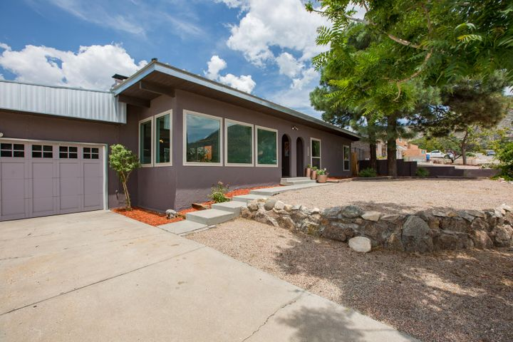 An amazing house in one of the best spots in Albuquerque! Sporting a clean, contemporary flair, the feels are off the chart! The natural light is amazing and the versatile floor plan is thoughtful and functional.  There is a separate second master that allows for multi generational use.  The large dining room could be used as a second living area AND this house has one of my ALL-TIME favorite features; an interior courtyard!! It's a fantastic, wonderful, private outdoor space!  There's even a pool and big backyard for the kids (of all ages)! So many updates >> windows, HVAC, kitchen, baths, lighting, flooring, ETC!  Located in Glenwood hills only moments from every conceivable service and amenity, bike trails, gym, shopping and transportation!  Great Schools as well. Thanks for looking!