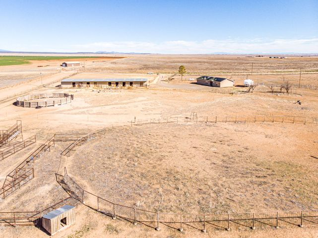 This New Mexico 40-acre equine property with a 1620 sf home features an 11-stall barn with hay storage, holding pens and riding arena. The 40 acres is fully fenced and cross-fenced and has good grass for horses to graze. Property is located just west of Estancia in Torrance County. The home consist of 3 bedrooms, two bathrooms, lovely master suite and a nice country kitchen. The Manzano Mountain views are magnificent especially at sunset. Solar panels on the roof make the home energy efficient with low electric bills. Albuquerque is about 60 minutes away and Santa Fe is roughly 90 minutes.