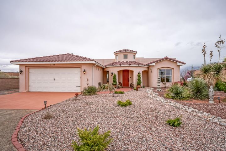 Stunning views!  Chic and elegant custom home in exclusive Tampico area of Rio Rancho. Move-in ready. Completely updated. Open floor plan, high ceilings, private outdoor spaces, decorative landscaping. Owned Solar! Interior updated with new cabinetry, granite/marble countertops, lighting, porcelain tile flooring.  Great room highlighted by custom kiva and wall of windows to take in the views. Kitchen includes new granite, glass-front cabinets, stainless steel appliances, wrap around breakfast bar. Formal/informal dining areas. Master suite features walk-in shower, jetted tub, his/her marble vanities, huge walk-in closet. Finished garage with built in storage. New water heater and water softener in 2017. RV parking. Security system. New landscape w/ drip. Clean, one of a kind property!