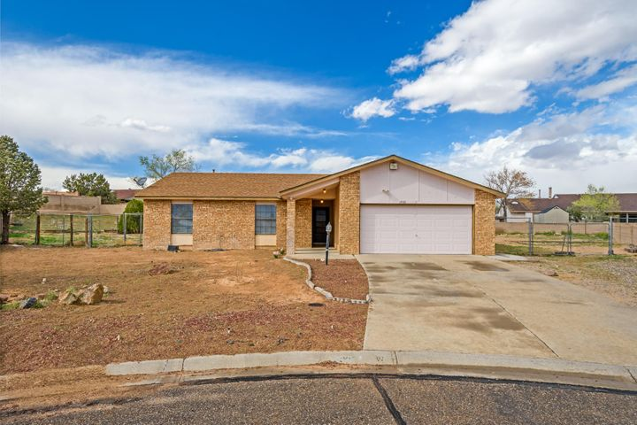 Tucked away in a Cul-de-sac, this home sits on 1/2 acre with side yard access to accommodate RVs, boats, and toys. Zero Landscape provides a blank canvas for any buyer to create their entertaining backyard with beautiful views of the Sandia mountains. New water heater, and replaced pipes throughout the home. NO POLY. A great opportunity to fix up this home with your personal choices!