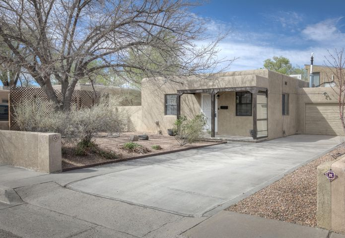 This wonderful North Summit Park home is a perfect fit! This 3 bedroom, 2 bath home with 2,115sf is around the corner from the UNM Law & Medical Schools, University Hospital, UNM North Golf course and walking trails, easy access to Wholefoods, Smith's and local amenities, not to mention centrally located in Albuquerque with quick commute times to all areas. The updated floor plan has an open kitchen with updated stainless steal appliances, butcher block countertops, added storage, plenty of natural light throughout, landscaped front & backyards, great covered patio and pride of ownership! This home is worth getting out to see in person!