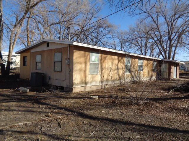 This 2 bedroom, 1 bathroom double-wide is situated on .75 acre in Peralta. It has a large living room with place for a wood stove. There is a country kitchen with extra storage room. It has an unfinished addition and enclosed patio. There are large shade trees. No mobile home title. The Seller must comply with HUD Guidelines 24 CFR 206.125. Property being sold as is.